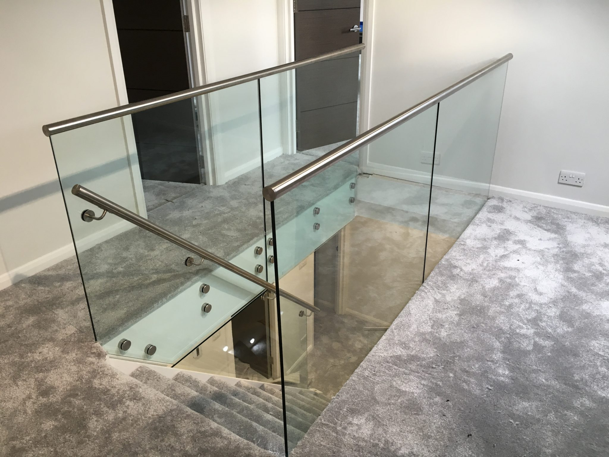 frameless glass balustrade with top mounted stainless steel handrail 1